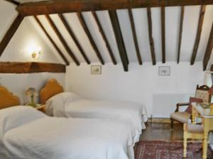 A bed or beds in a room at Tiplen Green Barn
