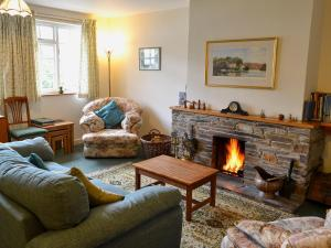 A seating area at Watercolour Cottage
