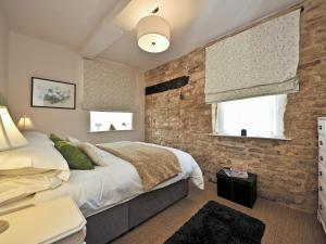 A bed or beds in a room at Thornton