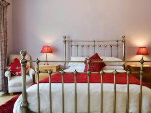 A bed or beds in a room at Saddle Room
