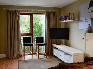 A television and/or entertainment center at Blossom Cottage