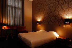 Een bed of bedden in een kamer bij Hotel Aan De Singel