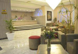 De lobby of receptie bij Hotel Liberty Resort