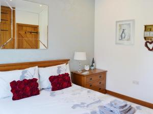 A bed or beds in a room at The Hide Away