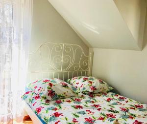 Łóżko lub łóżka w pokoju w obiekcie Optima