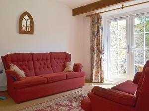A seating area at Half Penny Cottage