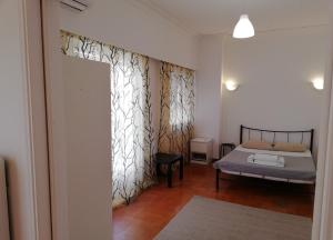A bed or beds in a room at Sfiggos 54 Guest House