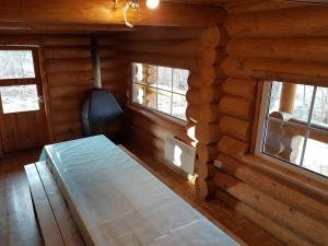 Voodi või voodid majutusasutuse Soomaa Water Camp toas