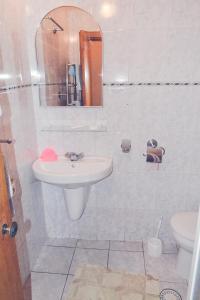 Ванная комната в Отель Жовтневый