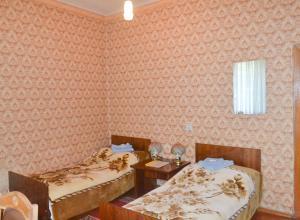 Кровать или кровати в номере Отель Жовтневый