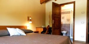 Letto o letti in una camera di La Locanda Del Lago Lucciola