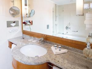 Ein Badezimmer in der Unterkunft Travel Charme Strandidyll Heringsdorf