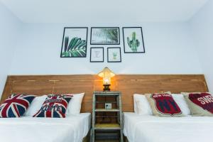 A bed or beds in a room at Homestay Nha Tui