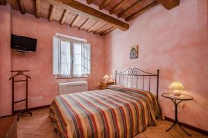 A bed or beds in a room at Casa Vacanze Il Campo