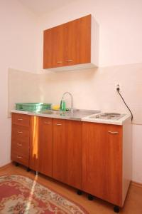 A kitchen or kitchenette at Apartments with a parking space Mlini, Dubrovnik - 8542