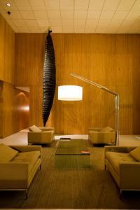 Uma área de estar em Hotel Emiliano