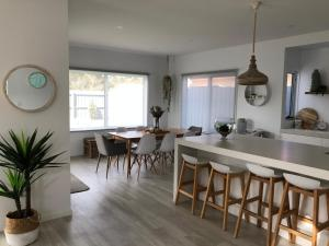A kitchen or kitchenette at Cove Place Retreat - Luxury Accommodation Phillip Island