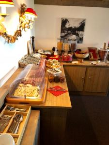 Cuisine ou kitchenette dans l'établissement Hôtel Arcadien