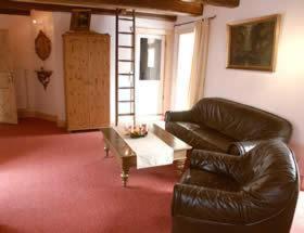 Ein Sitzbereich in der Unterkunft Pension Picco-Bello