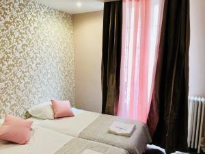 Un ou plusieurs lits dans un hébergement de l'établissement Appi Hotel