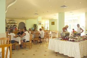 A restaurant or other place to eat at Sunny Day Club Hotel