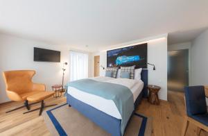 Телевизор и/или развлекательный центр в Leoneck Swiss Hotel