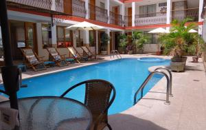 The swimming pool at or near Hotel Las Flores