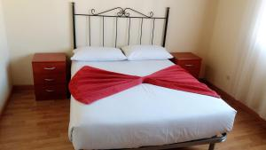 A bed or beds in a room at Casa Rural Claudia