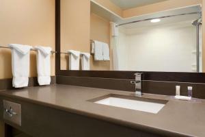 A bathroom at Days Inn & Suites by Wyndham Brandon