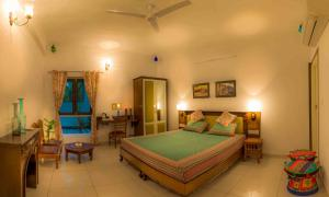 A bed or beds in a room at The Coral Court Homestay