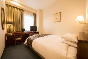 A bed or beds in a room at Dukes Hotel Nakasu