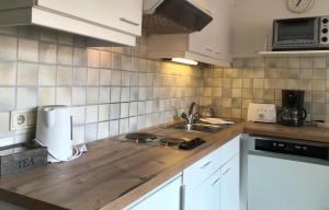 Kuchnia lub aneks kuchenny w obiekcie Appartement Posthäusl