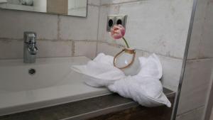 Ein Badezimmer in der Unterkunft Gästehaus Strausberg