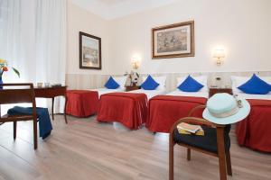 Un ou plusieurs lits dans un hébergement de l'établissement Hostel Carlito