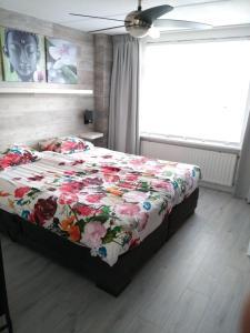 Een bed of bedden in een kamer bij Slapen in Dordrecht