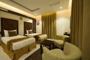 Cama ou camas em um quarto em Sharurah Plaza Hotel