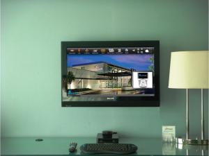 A television and/or entertainment center at Crowne Plaza Chicago O'Hare Hotel & Conference Center, an IHG Hotel