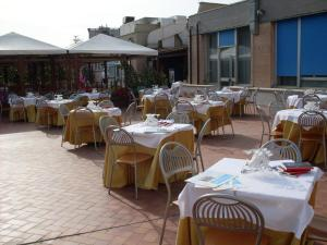 A restaurant or other place to eat at Villa Eur Parco Dei Pini