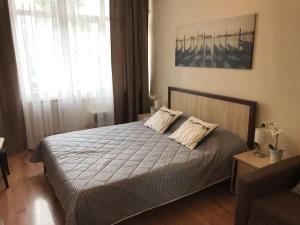 Кровать или кровати в номере Александра