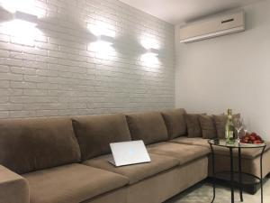 A seating area at Apartment on Okeanskiy Prospekt