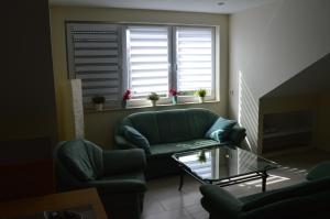 A seating area at Apartment Meerfeld