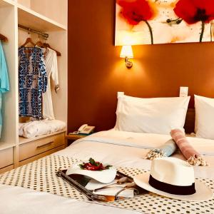 A bed or beds in a room at G George
