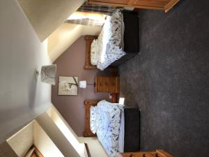 A bed or beds in a room at Greannan Upper Self Catering Apartment