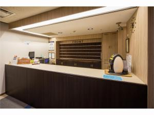 The lobby or reception area at Capsule Inn Sapporo (Male Only)
