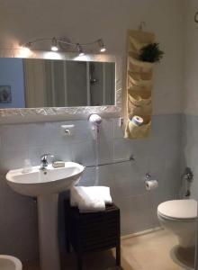 Um banheiro em Affittacamere PZ