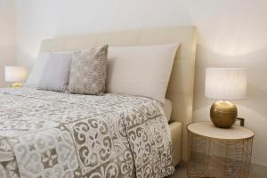 A bed or beds in a room at HomeAway Salerno