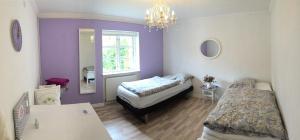 En eller flere senge i et værelse på Piccobello Bed & Breakfast Valløby Køge