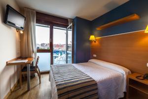Cama o camas de una habitación en Hotel La Polar