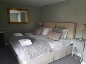 A bed or beds in a room at The Angel Inn
