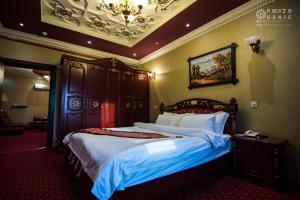 Cama ou camas em um quarto em Rabigh Tower Hotel